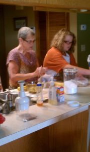 Mom teaching Rebecca in the kitchen